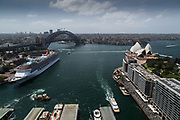 Open Sydney presented by Sydney Living Museuems. This event every year allows Sydneysiders to visit 40 of the city's most significant buildings and spaces across the CBD. Views of Circulay Quay from AMP Building rooftop showing Sydney Harbour, Opera House, Sydney Harbour Bridge and Cruise Ship, Sydney.