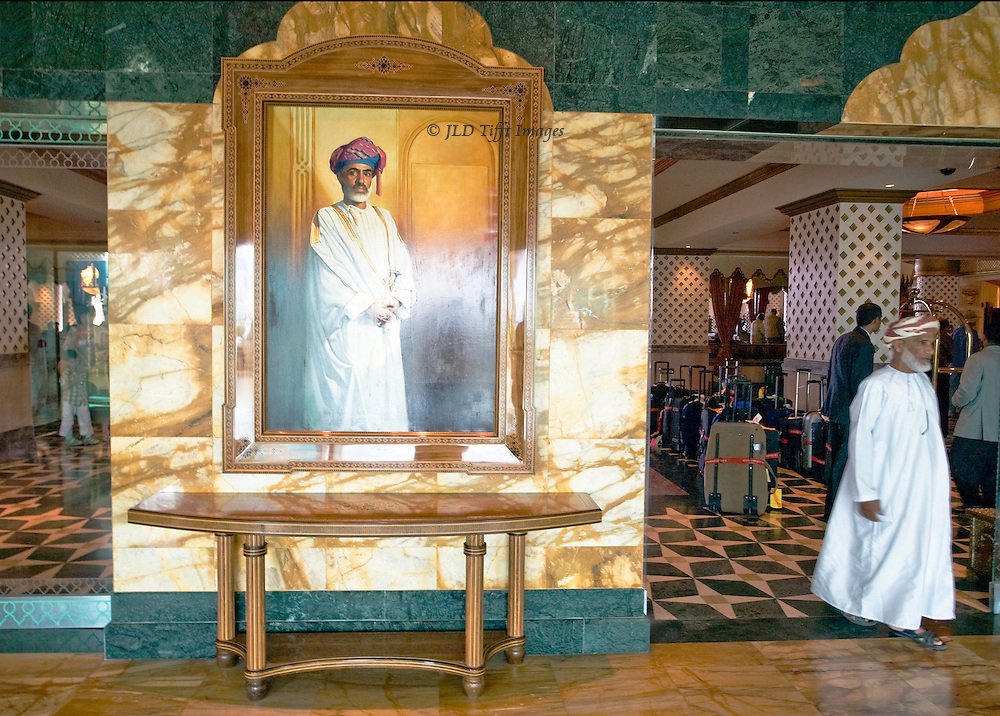 Portrait of Sultan Qaboos of Oman dominates the entrance to the hotel lobby, Muscat Grand Hyatt.