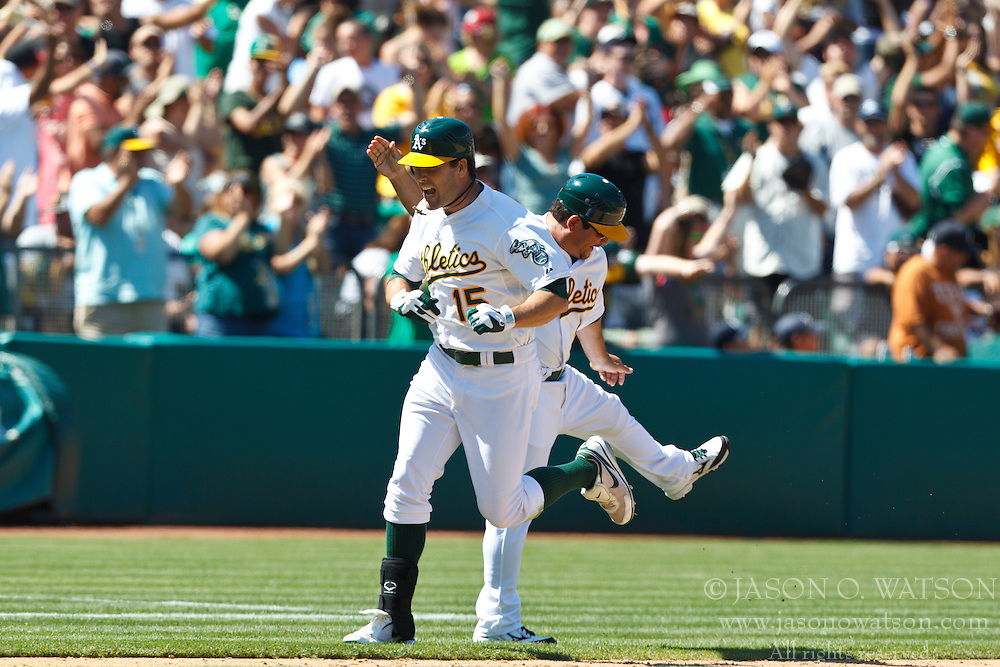 OAKLAND, CA - JULY 22: Seth Smith #15 of the Oakland Athletics is congratulated by third base coach Mike Gallego #3 (right) after hitting a game-tying home run against the New York Yankees during the ninth inning at O.co Coliseum on July 22, 2012 in Oakland, California.  The Oakland Athletics defeated the New York Yankees 5-4 in 12 innings. (Photo by Jason O. Watson/Getty Images) *** Local Caption *** Seth Smith; Mike Gallego