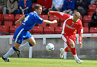 Photo: Ed Godden.<br />Swindon Town v Stockport County. Coca Cola League 2. 26/08/2006. Christian Roberts (R) and Tony Dinning (L).