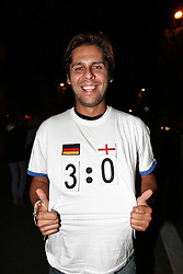 23.06.2010, Leopoldstrasse Schwabing, Muenchen, GER, FIFA Worldcup, Fanfeier nach Ghana vs Deutschland,  im Bild Fan mit T-Shirt Deutschland England  , EXPA Pictures © 2010, PhotoCredit: EXPA/ nph/  Straubmeier / SPORTIDA PHOTO AGENCY