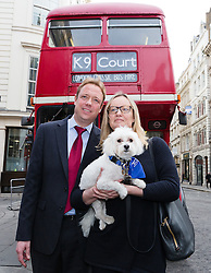 © Licensed to London News Pictures. 20/02/2017. LONDON, UK.  Gabby (Gabrielle) and Florian Kuehn with Vinnie outside the dog bus at Mayor's and City of London court in London for a hearing against their property management company, Victory Place. Gabby and Florian Kuehnn from Limehouse in east London claim they were told their pet dog, a Yorkshire terrier cross, Vinnie could live in their flat when they purchased it, but the management firm, Victory Place has subsequently insisted it has has a blanket no-pets policy. The animal rescue charity, All Dogs Matter are backing the couple and says no-pet rules see thousands of pets dumped each year and the rules are particularly unfair on the elderly and vulnerable who rely on pets for support and companionship.  Photo credit: Vickie Flores/LNP