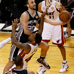 Jun 20, 2013; Miami, FL, USA; San Antonio Spurs shooting guard Manu Ginobili (20) lays the ball up as he collides with Miami Heat power forward Udonis Haslem (40) during the second quarter of game seven in the 2013 NBA Finals at American Airlines Arena. Mandatory Credit: Derick E. Hingle-USA TODAY Sports
