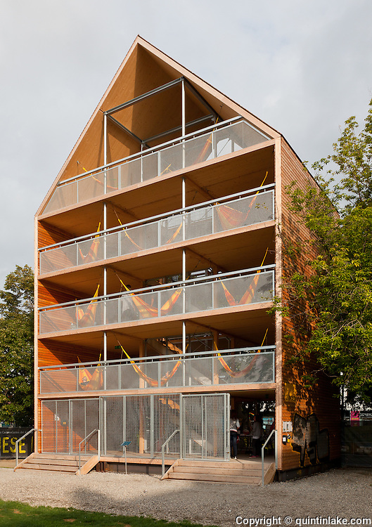 Hammock House / Flederhaus  Museums Quartier, Vienna. This house-shaped structure invites people to come in, relax in one of its many hammocks and enjoy their surroundings from a new point of view. Architect: Heri and Salli. Opened 2010
