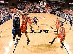 Virginia forward Mike Scott (32) blocks a shot by Duke forward Kyle Singler (12).  The Virginia Cavaliers men's basketball team faced the Duke Blue Devils at the University of Virginia's John Paul Jones Arena in Charlottesville, VA on March 5, 2008.