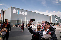 Basel, 16th of June 2014: ArtBasel 2014 Art Fair.<br /> A vip guest of Art Basel Unlimited exhibition takes a selphie with art performers Eva&Adele outside of Messehalle. <br /> Credits: Niels Ackermann / Lundi13