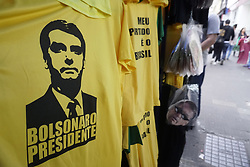 October 6, 2018 - Sao Paulo, Sao Paulo, Brazil - On the eve of the election for the Brazilian Presidency, an important shopping center in São Paulo sells t-shirts and masks by Jair Bolsonaro.The candidate for the presidency of Brazil for the Social Liberal Party (PSL), Jair Messias Bolsonaro, is an old acquaintance of politics who became the hope of millions of Brazilians change the country. Born March 21, 1955, the military in the reserve began his political career in 1988, when he was elected as an alderman in Rio de Janeiro by the Christian Democratic Party (PDC). With a popular and extreme right-wing speech, Bolsonaro has become the hope of millions of citizens who see in him the solution to the problems of insecurity that exist in Brazil, although it is also the fear of his detractors, who consider him a threat to democracy  (Credit Image: © Cris Faga/NurPhoto/ZUMA Press)