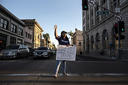 September 5, 2017 - Santa Ana, California, U.S. - A DACA supporting demonstrator directs other demonstrators on Fourth Street in Santa Ana on Tuesday. (Credit Image: © Kyusung Gong/The Orange County Register via ZUMA Wire)