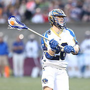 John Haus #26 of the Charlotte Hounds looks to pass the ball during the game at Harvard Stadium on May 17, 2014 in Boston, Massachuttes. (Photo by Elan Kawesch)