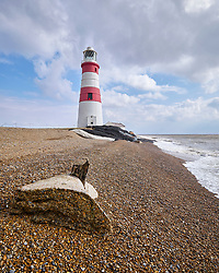 The old lighthouse on Orford Ness in Suffolk is in imminent danger of falling into the sea as the shingle beneath it is eroded. The little cottage seen on the far side of the lighthouse here in April 2019 was destroyed in a storm in September 2019.