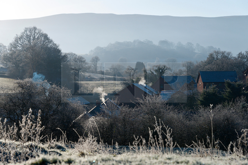 © Licensed to London News Pictures. 05/01/2017. Builth Wells, Powys, Wales, UK. Smoke rises from chimneys in the small market town of Builth Wells in Powys, Wales, amidst  a frosty early morning landscape after temperatures dropped to minus 4 degrees centigrade last night. Photo credit: Graham M. Lawrence/LNP