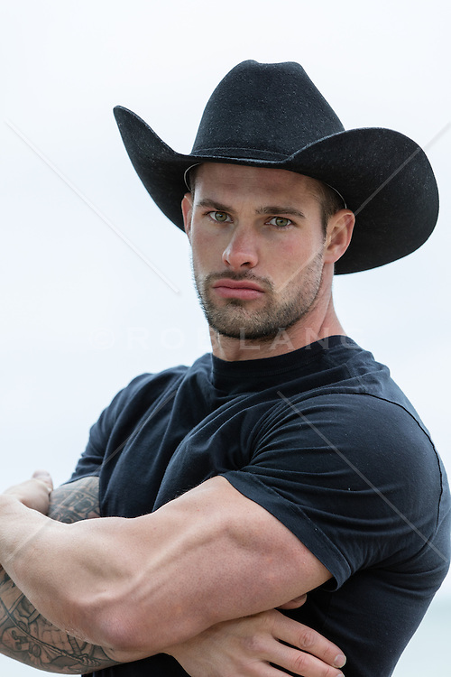 Portrait of a handsome rugged cowboy with green eyes and brown hair