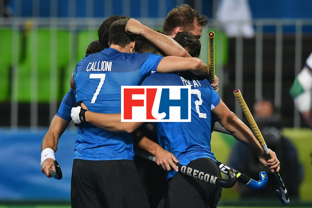 Argentina's players celebrate scoring during the mens's field hockey Ireland vs Argentina match of the Rio 2016 Olympics Games at the Olympic Hockey Centre in Rio de Janeiro on August, 12 2016. / AFP / MANAN VATSYAYANA        (Photo credit should read MANAN VATSYAYANA/AFP/Getty Images)