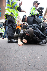"© Licensed to London News Pictures . 20/10/2012 . London , UK . Police detain a man on Oxford Street following an attempt by Black Bloc protesters to shops along the road . The TUC march in London against austerity and cuts , under the banner "" March for a future that works "" . Photo credit : Joel Goodman/LNP"