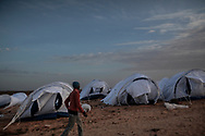 After crossing  border from Lybia, migrants workers arrive in an UNHCR transit camp in Choucha, 7 km from Tunisia's Ras Jdir border station. They will be hold in this tents camp waiting for repatriation to their home countries. 04 March 2012.