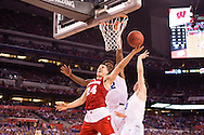 06 APR 2015:  Guard Bronson Koenig (24) of the University of Wisconsin strains for a shot in front of Forward Justise Winslow (12) and Guard Grayson Allen (3) of Duke University during the championship game at the 2015 NCAA Men's DI Basketball Final Four in Indianapolis, IN. Duke defeated Wisconsin 68-63 to win the national title. Brett Wilhelm/NCAA Photos