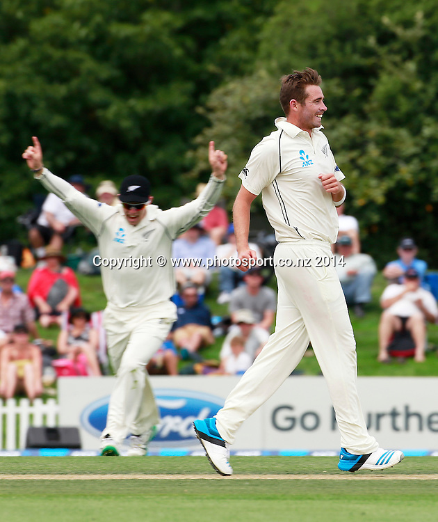 Tim Southee of the Black Caps and Tom Latham react to a Sri Lankan wicket on Day 2 of the boxing Day Cricket Test Match between the Black Caps v Sri Lanka at Hagley Oval, Christchurch. 27 December 2014 Photo: Joseph Johnson / www.photosport.co.nz