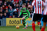 Forest Green Rovers midfielder Charlie Cooper (15)  during the EFL Sky Bet League 2 match between Lincoln City and Forest Green Rovers at Sincil Bank, Lincoln, United Kingdom on 30 December 2017. Photo by Simon Davies.
