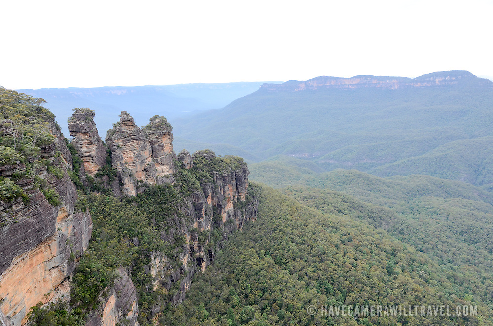 A wide-angle shot of the Three Sisters in the Blue Mountains as seen from Echo Point in Katoomba, New South Wales, Australia.