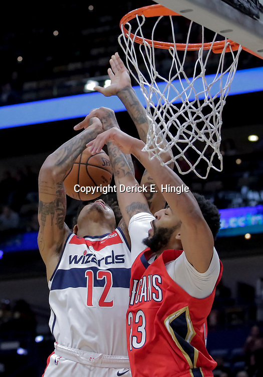 Nov 28, 2018; New Orleans, LA, USA; New Orleans Pelicans forward Anthony Davis (23) blocks a shot by Washington Wizards forward Kelly Oubre Jr. (12) during the first quarter at the Smoothie King Center. Mandatory Credit: Derick E. Hingle-USA TODAY Sports