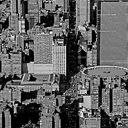 Aerial photo above 8th Avenue traffic, and the noticeably circular Madison Square Garden