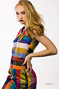 Houston fashion model Lauren Burke in vivid block plaid dress strikes a runway pose.