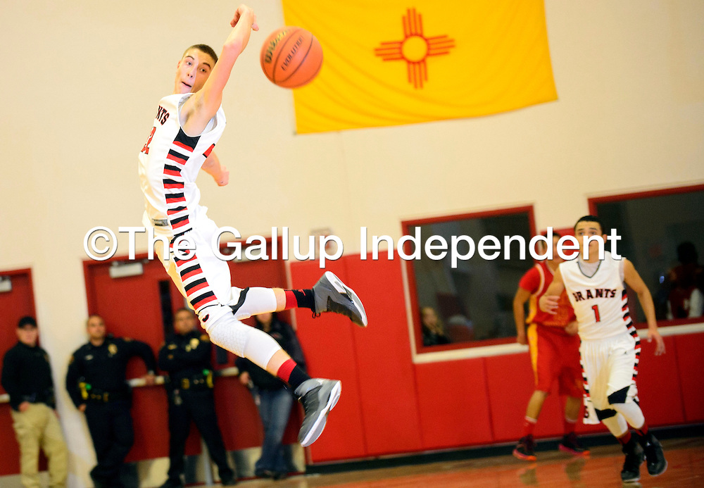 112613  Adron Gardner/Independent<br /> <br /> Grants Pirate XXX (32) leaps to pick off an Espa&ntilde;ola Valley Sundevil pass in Grants Tuesday.