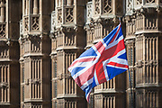 On the day that Prime Minister Theresa May returns to Brussels to negotiate an expected Brexit delay, the Union jack flag flies as pro-EU remainers protest outside Westminster Abbey opposite parliament in Westminster, in London, England.