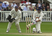 .Photo Peter Spurrier.Sport - Cricket.22/06/02.Bensen & Hedges Cup Final Lords Ground.Jim Troughton plays a reverse sweep with keeper Andy Flower watching on.. [Mandatory Credit: Peter Spurrier:Intersport Images]