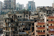 "View from the Sunni neighborhood Bab al-Tebbaneh to the Alawite Jabal Mohsen neighborhood, supporting the regime of Syrian President Assad. The portrait of the leader of the Arab Democratic Party, in fact a leader of an armed militia, is visible on a building at the top. Separated by the ""Syria Street"", the two communities are fighting using war weapons. Tripoli, Lebanon....Vue à partir du quartier sunnite de Bab al-Tebbaneh- vers le quartier alaouite Jabal Mohsen,  sympathisant du régime du président syrien Assad. Le portrait du leader du Partie Arabe Démocratique, en réalité un chef d'une milice armée est visible en haut. Séparés par la rue de Syrie, les deux communautés se combattent avec des armes de guerre. Tripoli, Liban"