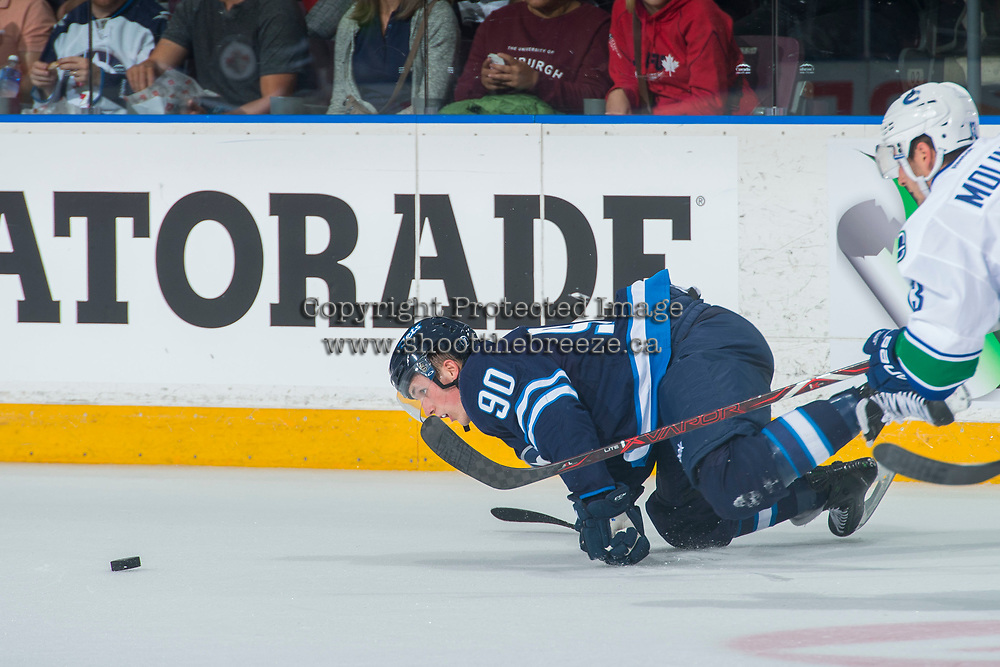 PENTICTON, CANADA - SEPTEMBER 8: Kristian Reichel #90 of Winnipeg Jets keeps his eye on the puck after falling to the ice against the Vancouver Canucks on September 8, 2017 at the South Okanagan Event Centre in Penticton, British Columbia, Canada.  (Photo by Marissa Baecker/Shoot the Breeze)  *** Local Caption ***