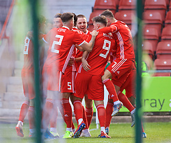 WREXHAM, WALES - Friday, September 6, 2019: Wales' Brennan Johnson (hidden) celebrates scoring his team's winning goal with team-mates during the UEFA Under-21 Championship Italy 2019 Qualifying Group 9 match between Wales and Belgium at the Racecourse Ground. Wales won 1-0. (Pic by Laura Malkin/Propaganda)