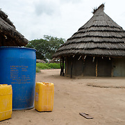 Water storage vessels in front of a homestead in the village of Kudo in Eastern Equatoria in South Sudan on 8 August 2014.