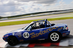 Andrew Wright in his Ma5da Racing Mk1 MX-5 enters The Esses at Snetterton.