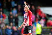 Exeter City's Lee Holmes dance in front of the travelling fans after the final whistle in the visitors 2-0 win in the Sky Bet League 2 match between Yeovil Town and Exeter City at Huish Park, Yeovil, England on 9 April 2016. Photo by Graham Hunt.