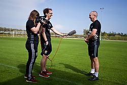 LARNACA, CYPRUS - Thursday, March 1, 2018: Wales' goalkeeper coach Jon Horton is interviewed by press officer Owain Harries during a training session in Larnaca on day three of the Cyprus Cup tournament. (Pic by David Rawcliffe/Propaganda)