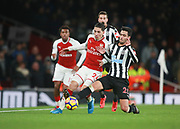 Arsenal's Hector Bellerin and Newcastle United's Mikel Merino and  during the Premier League match between Arsenal and Newcastle United at the Emirates Stadium, London, England on 16 December 2017. Photo by John Marsh.