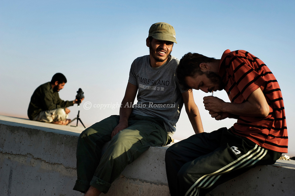 LIBYAN ARAB JAMAHIRIYA, Twama : Libyan rebels in the outpost of Twama, 30 km south-east of the western stronghold Zintan, on July 15, 2011. The lone outpost is the last defensive position of the rebels in the south of the Nafusa mountains.ALESSIO ROMENZI