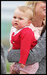 Prince George in the arms of his mother the Duchess of Cambridge as they  leave Canberra airport in Australia at the end of the Royal Tour , Friday, 25th April 2014. Picture by Stephen Lock / i-Images