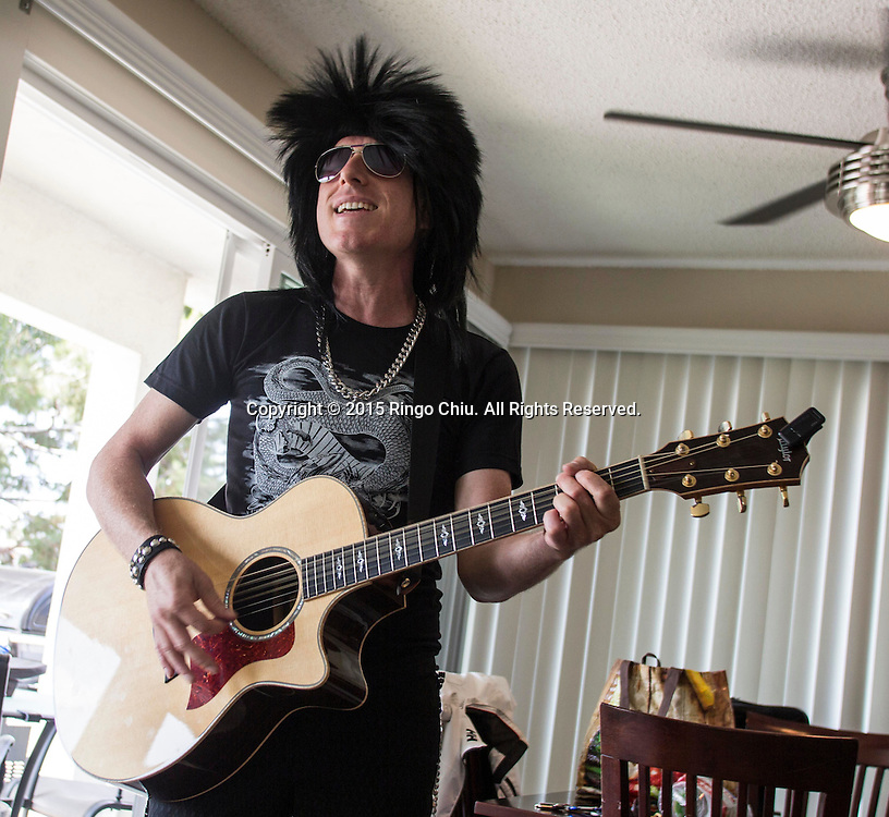 Brian Silverman, singing telegram performer, in a performance as he surprises a birthday party.<br /> (Photo by Ringo Chiu)<br /> Photo by Ringo Chiu/PHOTOFORMULA.com)