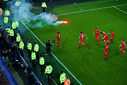 LIVERPOOL, ENGLAND - Monday, December 19, 2016: Liverpool's Sadio Mane celebrates scoring a late injury-time winning goal against Everton, to seal a 1-0 victory, as a red flare smokes on the pitch, during the FA Premier League match against Liverpool, the 227th Merseyside Derby, at Goodison Park. (Pic by Gavin Trafford/Propaganda)