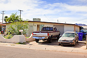 "15 AUGUST 2011 - PHOENIX, AZ: The front of the home that Ame Deal, a 10 year old girl allegedly murdered by her family when she was locked in a footlocker, lived in in Phoenix, AZ. Phoenix police homicide investigators have arrested four people in connection to the death of the 10-year-old girl whose body was found inside a box on July 1, 2011. Police originally thought a game of hide-and-seek had turned deadly but now say family members fabricated the story. During the initial investigation, the family had told police that Ame Lynn Deal and other children were playing hide-and-seek and they believed that Ame must have climbed into the storage box to hide and had accidentally suffocated. According to Sgt. Trent Crump with the Phoenix Police Department, investigators determined that Ame was forced into the footlocker-type box as punishment for stealing a Popsicle from the refrigerator. The box was padlocked and Ame was left in it overnight at her home near 35th Avenue and Broadway Road. She was found dead the following morning. Crump said Ame was forced to do backbends for several hours prior to dragging the chest inside the house herself. He described the box as 31.5 inches in length, 14 inches wide and 12.25 inches deep. At the time of her death, Ame was 4 feet 2 inches tall and weighed 60 pounds. Ame's family members regularly locked her in the box as discipline for poor behavior, according to Crump. There were allegations that she was fed hot sauce, deprived of food and beaten with a board over the past few months. He said when Ame wouldn't pick up dog feces, it was rubbed on her and she was forced to eat it. ""This child died at the hands of those who were supposed to love and care for her... this case has turned the stomachs of some of our most seasoned detectives,"" Crump said. John Allen and his wife, Samantha Allen, both 23, confessed to placing and padlocking Ame in the box on July 12. They were left in charge of Ame that night. They were charged with first-d"
