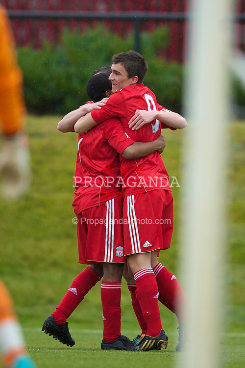 KIRKBY, ENGLAND - Saturday, January 15, 2011: Liverpool's Adam Morgan celebrates scoring the opening goal against Bolton Wanderers during the FA Academy Under 18s League match at the Kirkby Academy. (Photo by David Rawcliffe/Propaganda)