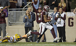 Texas A&M wide receiver Christian Kirk (3) crosses the goal line as LSU safety John Battle (26) was not able to stop him after a catch and run during the first quarter of an NCAA college football game Thursday, Nov. 24, 2016, in College Station, Texas. (Sam Craft/The Eagle)