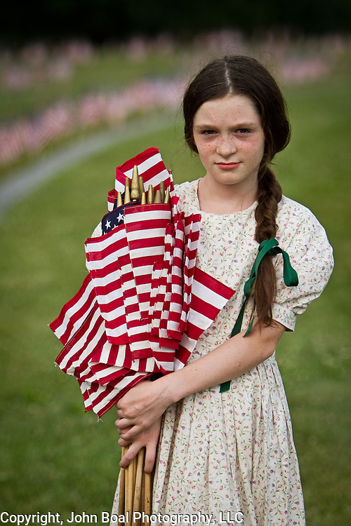 Erica Neemeyer, 11, planted flags with her family at the Soldiers National Cemetery, during the Sesquicentennial Anniversary of the Battle of Gettysburg, Pennsylvania on Sunday, June 30, 2013.  A pivotal moment in the Civil War, over 50,000 soldiers were killed, wounded or missing after 3 days of battle from July 1-3, 1863.  Later that year, President Abraham Lincoln returned to Gettysburg to deliver his now famous Gettysburg Address to dedicate the cemetery there for the Union soldiers who died in battle.