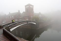 © Licensed to London News Pictures. 15/09/2016. Birmingham, West Midlands,  UK. Heavy fog envelopes the  Birmingham canal system ahead of a day of temperatures forecast to reach 25 deg centigade in Birmingham, West Midlands, UK. Photo credit: Graham M. Lawrence/LNP
