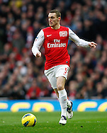 Picture by Andrew Tobin/Focus Images Ltd. 07710 761829. .21/01/12. Thomas Vermaelen (5) of Arsenal on the ball during the Barclays Premier League match between Arsenal and Manchester United at Emirates Stadium, London.