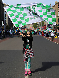 Hibernian Scottish Cup Open Top Bus Edinburgh 14 May 2016; Hibs fan on Leith Walk waves her flag during the open top bus parade in Edinburgh after winning the Scottish Cup.<br /> <br /> (c) Chris McCluskie | Edinburgh Elite media