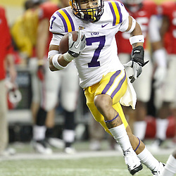 Dec 3, 2011; Atlanta, GA, USA; LSU Tigers cornerback Tyrann Mathieu (7) returns a punt for a touchdown against the Georgia Bulldogs during the first half of the 2011 SEC championship game at the Georgia Dome.  Mandatory Credit: Derick E. Hingle-US PRESSWIRE