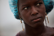 CLIENT: SAVE THE CHILDREN<br /> <br /> A young woman is pelted by rain as Hurricane Tomas passes through in the Jean-Marie Vincent tent camp near the Cite Soleil neighborhood in Port-au-Prince, Haiti.